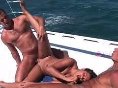 Two sailors fuck a curvy brunette in all holes on deck